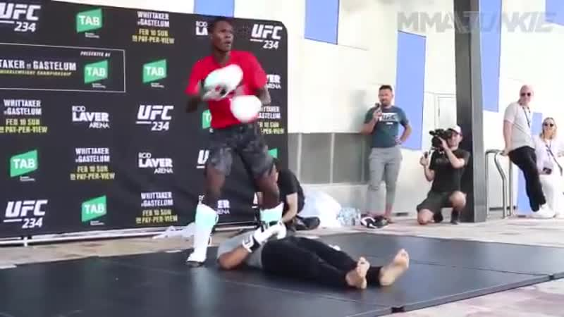 Watch Israel Adesanya bust out the old-school @WWE finishers during UFC234 open workouts!