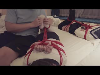 Two students tied on bed