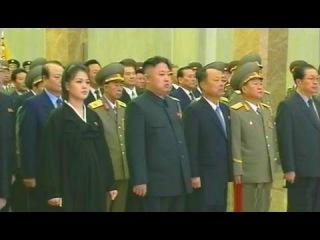 KCTV (Kim Jong Un and his wife Ri Sol Ju Pays Respects to Kim Jong Il)