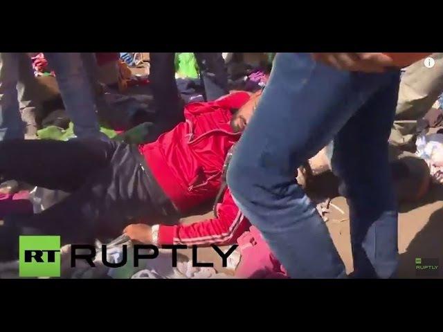 Венгрия Полиция драка с беженцами в лагере возле временного Рьоске один ранен
