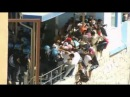 Italian police beat migrants in Lampedusa clashes