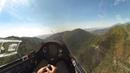 Glider Diving Through Canyon