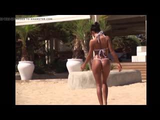 Sexy baby in daring string bikini on the beach