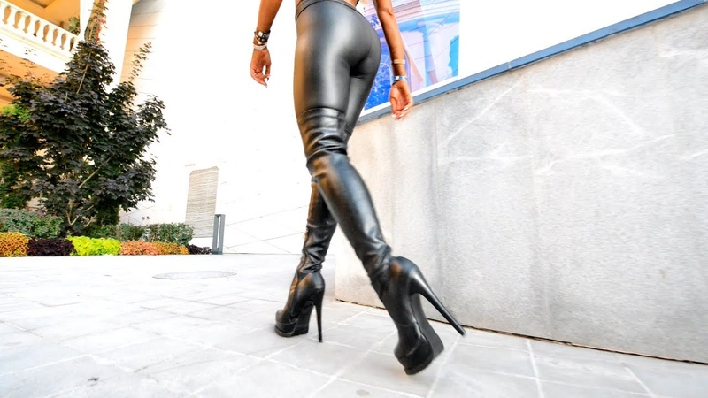 Walking Blonde in high leather boots Girl in leggings